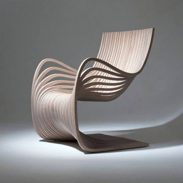 "For the Guatemalan brand Piegatto, designer Alejandro Estrada has imagined ""The Pipo Chair"" a plywood chair which curves and different layers wave in an elegant way. 29 wooden strands were cut from"